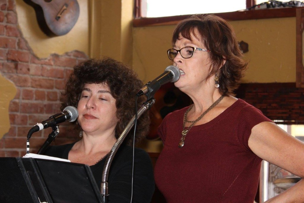 Alexandria Belchef and Victoria Payne singing a capella.
