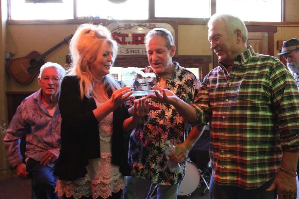 Sue and Phil receiving a Award of Merit from Steve Smelser of the BMHOF